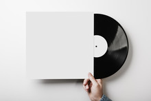 Hand Holding Vinyl Music Album Template On White Wall Background