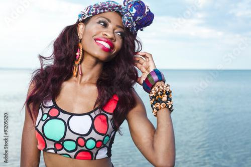 fototapeta na lodówkę African American girl relaxing at the beach.