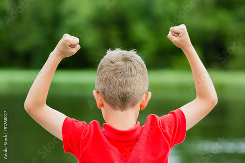 Fotografie, Obraz  Back of child with fists in the air