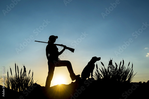 Aluminium Prints Hunting Female Hunter in Sunset