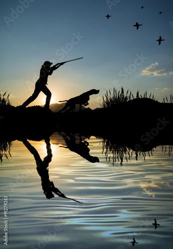 Poster Jacht Silhouette of woman hunter at sunset. Duck hunting with dogs.