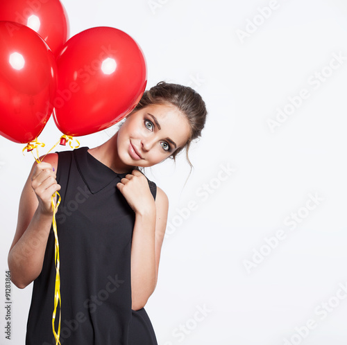 Photo  Smiling girl with balloons on a white background isolated