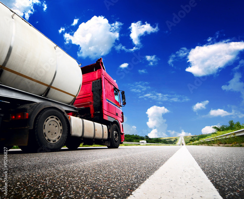 fototapeta na drzwi i meble Semi Truck In Motion. Speeding Truck on the Highway