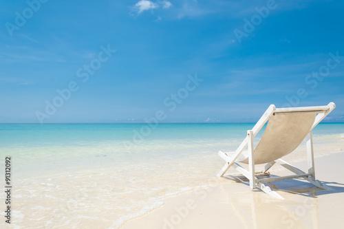 Slika na platnu beach chair on beach with blue sky