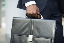 Businessman Holding His Briefc...