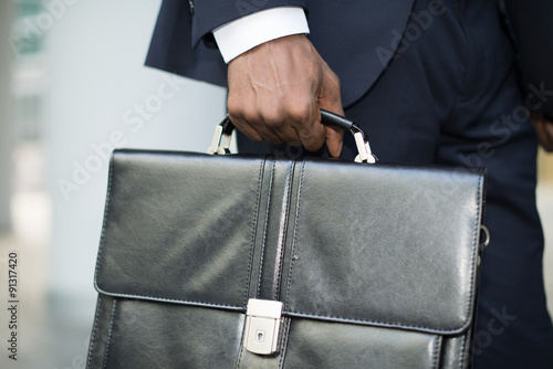 Businessman holding his briefcase Canvas Print