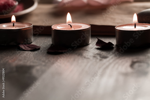 Poster de jardin Spa Beautiful Spa composition with aroma candles and empty vintage open book on wooden background. Treatment, aromatherapy