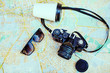 Top view retro camera, cup and sunglasses
