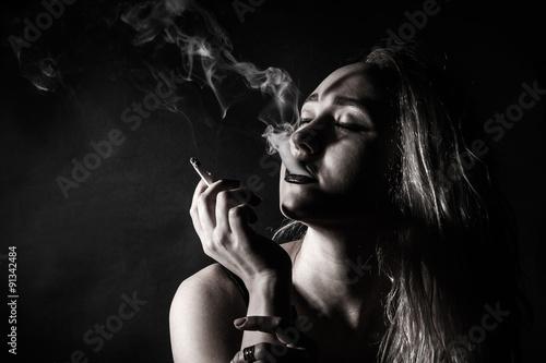 Fototapety, obrazy: Beautiful young woman smoking a cigarette