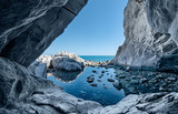 Fototapeta Przestrzenne - sea cave rocks. Grotto with water reflections
