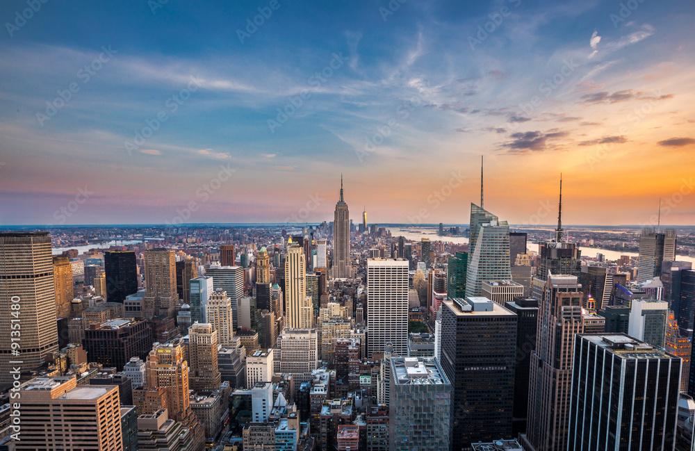 Fototapety, obrazy: New York City midtown skyline at sunset.