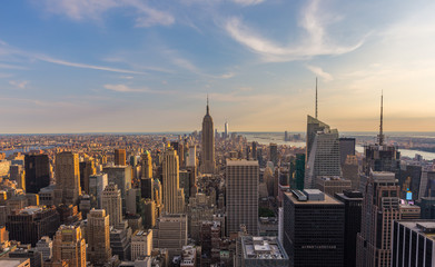New York City downtown skyline at sunset.