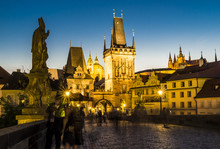 Charles Bridge With Tower And People By Night