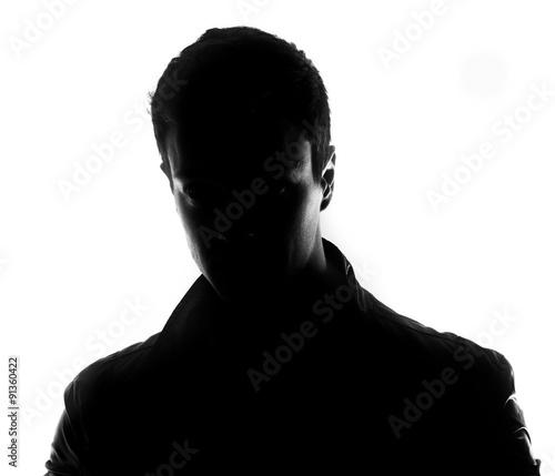 Fotografie, Tablou Hidden face in the shadow.male silhouette.