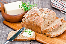 Sliced Irish Stoneground Soda Bread With Butter And Thyme On The