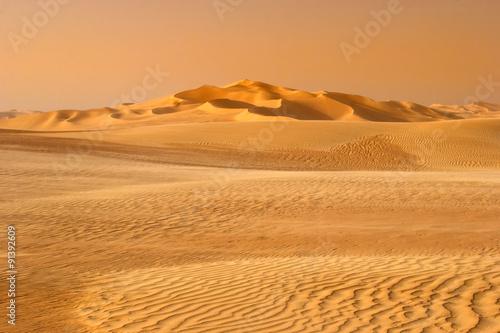 Poster Oranje eclat sunset in the sand-dune desert
