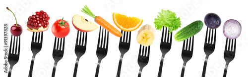 Poster Légumes frais Color fruits and vegetables on fork