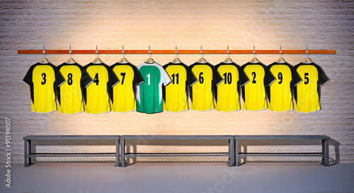 Fotografie, Obraz  Row of Yellow and Green  Football Shirts hanging on wall with Bench