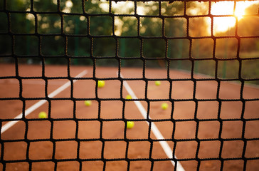 Panel Szklany Tenis Close up of tennis net with balls in background