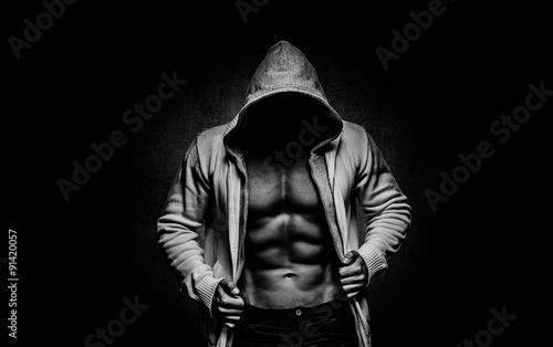 Fotografie, Obraz  strong athletic man on black background
