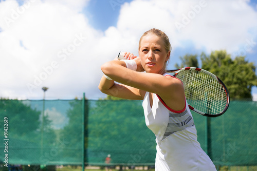 Woman playing tennis Wallpaper Mural