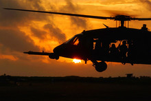 Helicopter Soldiers At Sunset