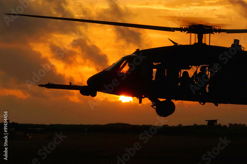 Helicopter soldiers at sunset Poster