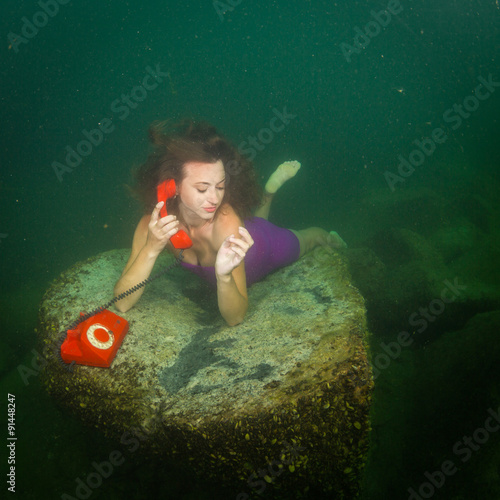 Underwater telephone call - Buy this stock photo and explore
