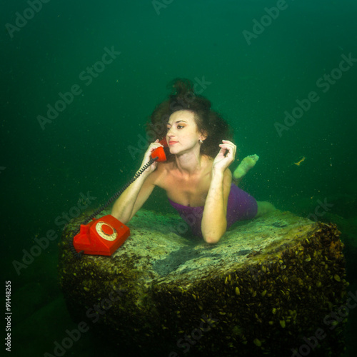 Underwater telephone call - Buy this stock photo and explore similar