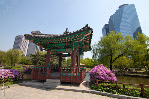 Traditional korean house in park in Seoul Poster