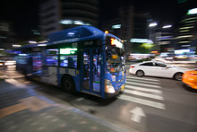 City Bus Motion Blurred In The Night
