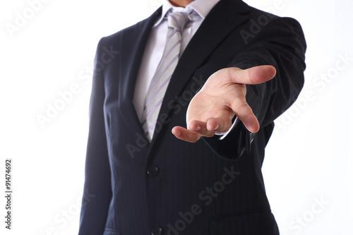 Valokuva  Yong businessman on white background