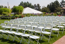 Folding Chairs At A Garden Wedding