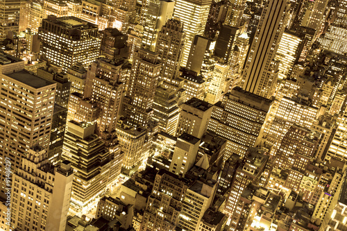 Golden cityscape of New York City buildings and lights at night - 91488297