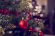 canvas print picture - Closeup of red bauble hanging from Christmas tree