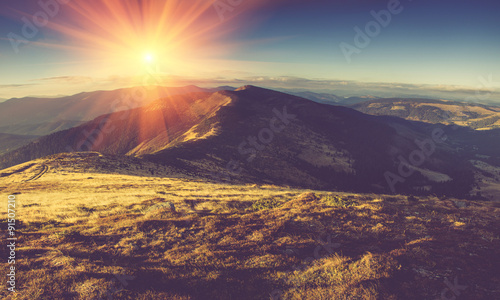 Scenic view of mountains, autumn landscape with colorful hills at sunset. #91507210