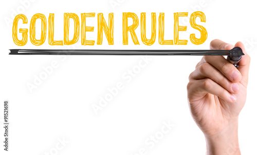 Photo  Hand with marker writing: Golden Rules