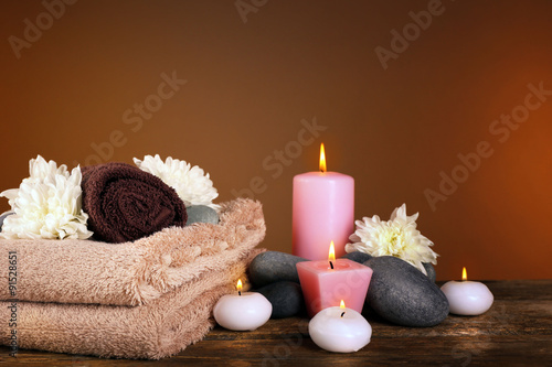 Poster Spa Beautiful spa composition with chrysanthemums on brown background