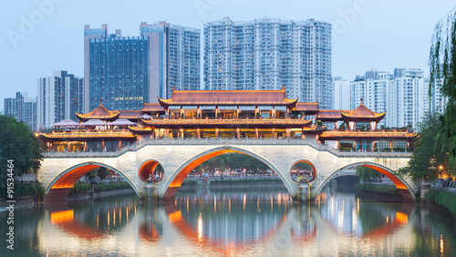 Anshun Bridge and river Jinjiang against buildings at dusk in Chengdu, Sichuan Province, China