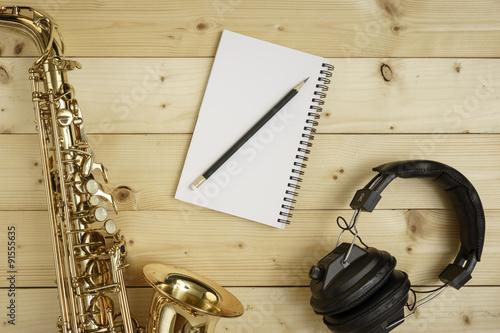 Photo Saxophone on the Wood Background