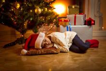 Girl Fell Asleep Under Christmas Tree While Waiting For Santa