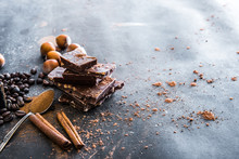 Chocolate, Nuts, Spices On Table
