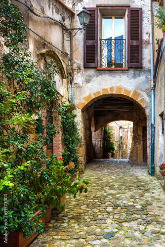 Spoed Foto op Canvas Mediterraans Europa Colored corners in the picturesque Italian village