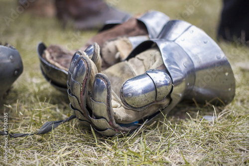 Photo  gauntlets on the ground: knight armour