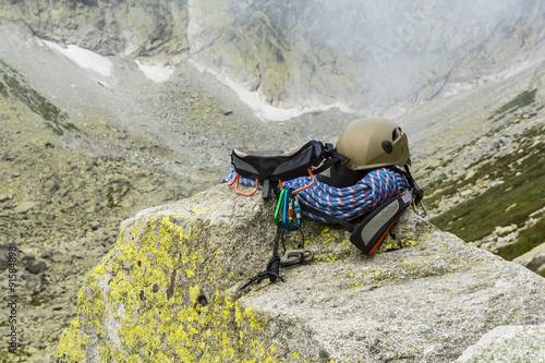Foto op Plexiglas Alpinisme Dynamic rope, helmet, carabiners, climbing harness and descender on the rock