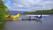 Float Planes Sit On A Small Bay On Loch Lomand, Scotland.