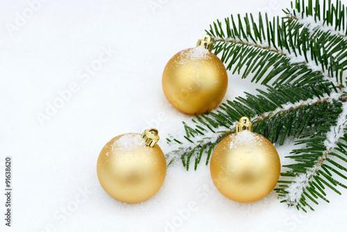 Goldene Weihnachtskugeln.Goldene Weihnachtskugeln Im Schnee Buy This Stock Photo And