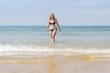 Beautiful young girl enjoying the beach in summer