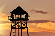 Silhouette Of A Watchtower Wit...