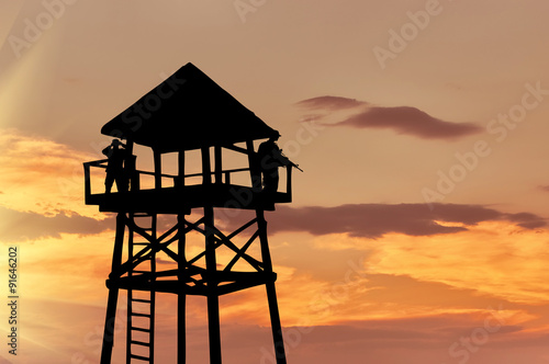Obraz na plátne Silhouette of a watchtower with soldiers